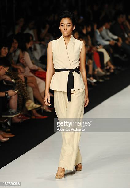 A model showcases designs by Auguste Soesastro on the runway at the Dutch Renaissance show during Jakarta Fashion Week 2014 at Senayan City on...