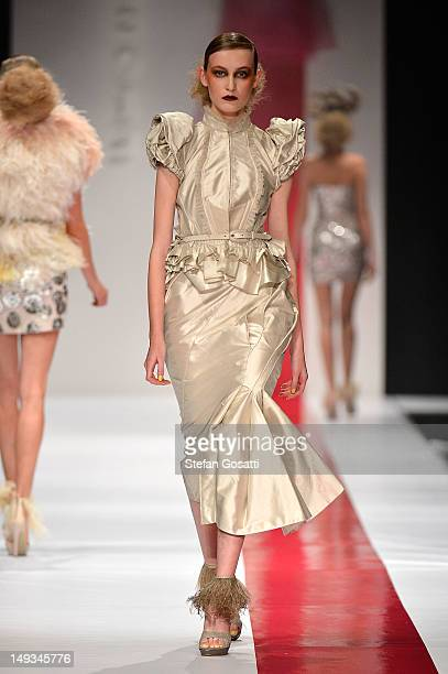 Model showcases designs by Aurelio Costarella on the catwalk during StyleAID 2012 at the Burswood Entertainment Complex on July 27, 2012 in Perth,...