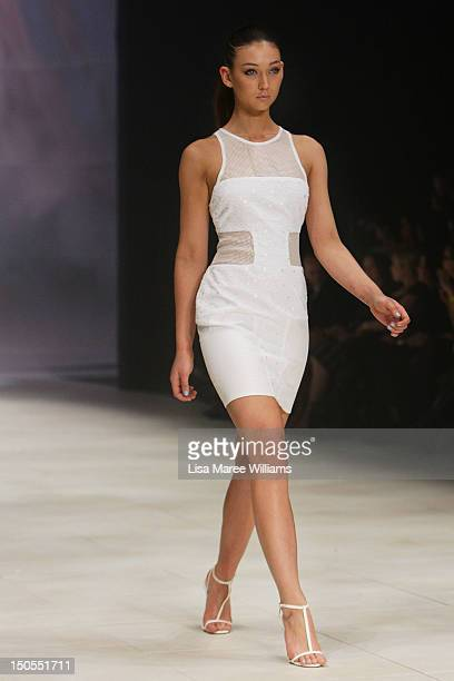 A model showcases designs by Bec Bridge on the catwalk as part of Mercedes Benz Fashion Festival Sydney 2012 at Sydney Town Hall on August 21 2012 in...
