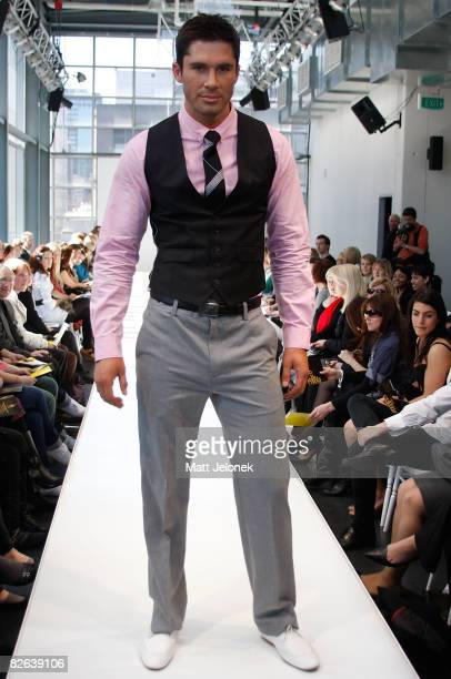 A model showcases designs by Ben Sherman as part of the Melbourne's GPO Racing into Spring Fashion Parade catwalk show on the second day of Melbourne...