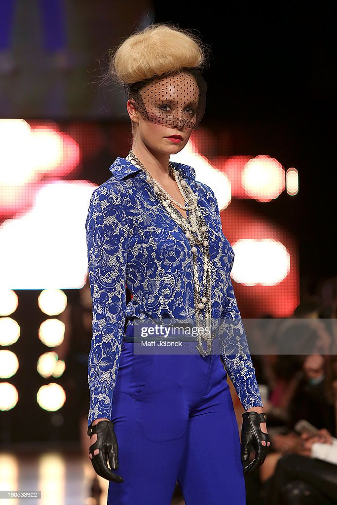 A model showcases designs by Betty Tran on the runway during Perth Fashion Festival at The Western Australian Museum on September 14, 2013 in Perth, Australia.