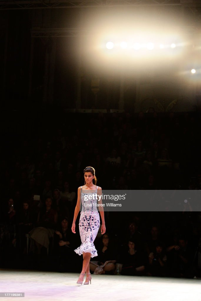 A model showcases designs by By Johnny on the runway at the MBFWA Trends show during Mercedes-Benz Fashion Festival Sydney 2013 at Sydney Town Hall on August 22, 2013 in Sydney, Australia.