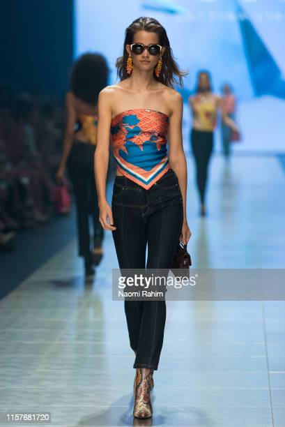 A model showcases designs by BYAL Bettina Liano during Runway 6 at Melbourne Fashion Festival on March 9 2019 in Melbourne Australia
