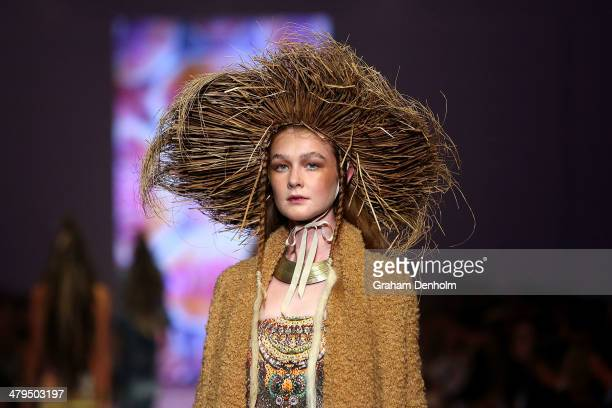 A model showcases designs by Camilla on the runway during the Camilla show as part of 2014 Virgin Australia Melbourne Fashion Festival at Docklands...