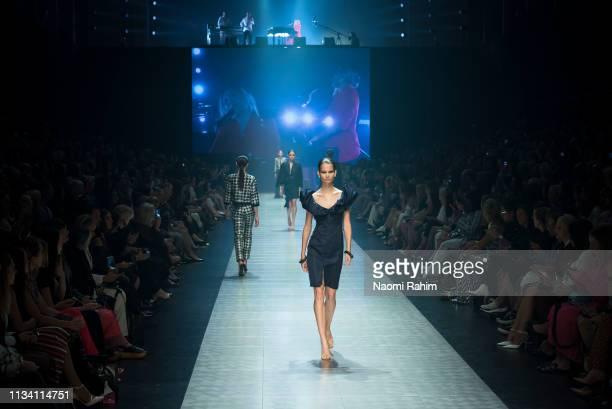 A model showcases designs by Carla Zampatti at Melbourne Fashion Festival on March 6 2019 in Melbourne Australia