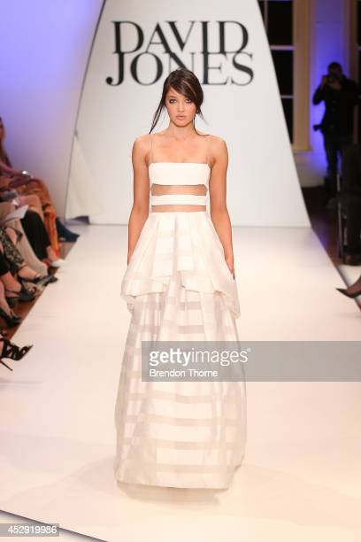 A model showcases designs by Carla Zampatti at the David Jones Spring/Summer 2014 Collection Launch at David Jones Elizabeth Street Store on July 30...