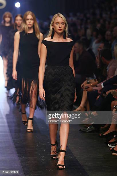 A model showcases designs by Carla Zampatti on the runway during the David Jones opening event as part of Virgin Australia Melbourne Fashion Festival...