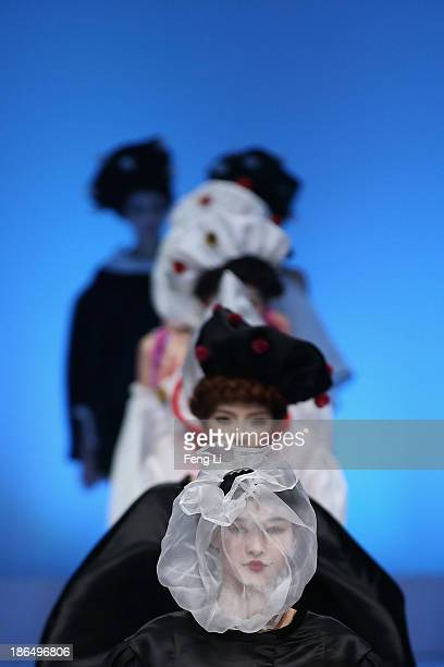 Model showcases designs by Chinese designer Cao Qinghe on the runway at HEMPEL Designer Salon Collection show during Mercedes-Benz China Fashion Week...