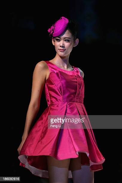 A model showcases designs by Chinese designer Yuan Bing on the runway at VISCAP Yuan Bing Collection show during MercedesBenz China Fashion Week...