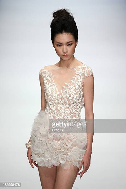A model showcases designs by Chinese designer Zhang Jingjing on the runway at Zhang Jingjing Haute Couture Collection show during MercedesBenz China...
