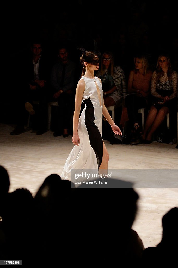 A model showcases designs by Christina Exie on the runway at the MBFWA Trends show during Mercedes-Benz Fashion Festival Sydney 2013 at Sydney Town Hall on August 24, 2013 in Sydney, Australia.