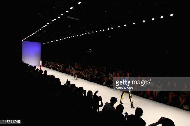 Model showcases designs by Christopher Baldwin in the Innovators group show on the catwalk on day four of Mercedes-Benz Fashion Week Australia...