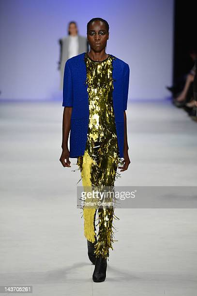 Model showcases designs by Christopher Baldwin on the catwalk on day four of Mercedes-Benz Fashion Week Australia Spring/Summer 2012/13 at the...