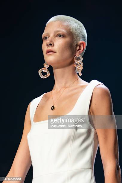 A model showcases designs by C/meo Collective during Runway 5 at Melbourne Fashion Festival on March 8 2019 in Melbourne Australia