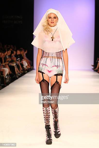 Model showcases designs by Collecting Pretty Boys on the catwalk during the New Generation 1 group show on day four of Mercedes-Benz Fashion Week...