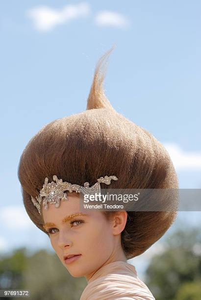 A model showcases designs by Collette Dinnigan during the Opening Night Party for the 2010 L'Oreal Melbourne Fashion Festival at Government House on...