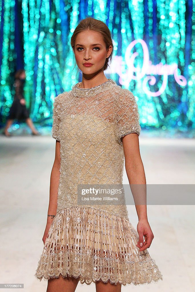 A model showcases designs by Collette Dinnigan on the runway at the InStyle Red Carpet Runway show during Mercedes-Benz Fashion Festival Sydney 2013 at Sydney Town Hall on August 22, 2013 in Sydney, Australia.