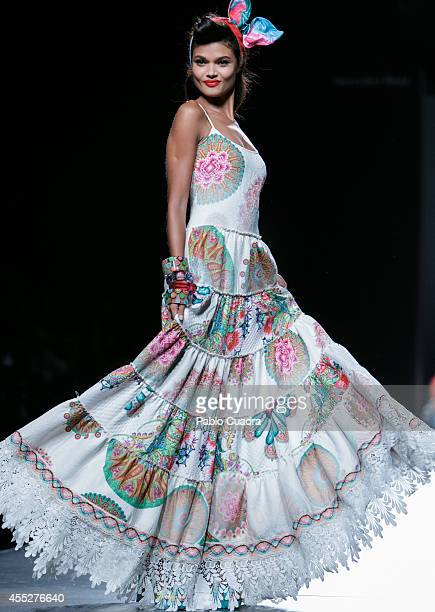 A model showcases designs by Desigual on the runway at Desigual show during Mercedes Benz Fashion Week Madrid Spring/Summer 2015 at Ifema on...