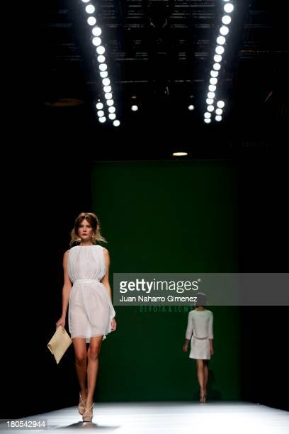 A model showcases designs by Devota Lomba on the runway at Devota Lomba show during Mercedes Benz Fashion Week Madrid Spring/Summer 2014 at Ifema on...