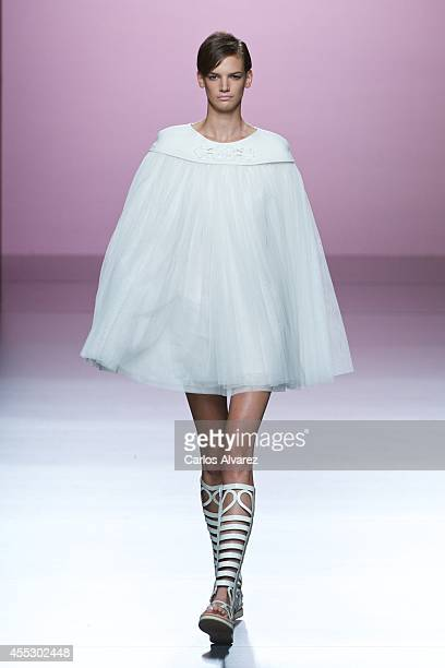 A model showcases designs by Devota Lomba on the runway at Devota Lomba show during Mercedes Benz Fashion Week Madrid Spring/Summer 2015 at Ifema on...