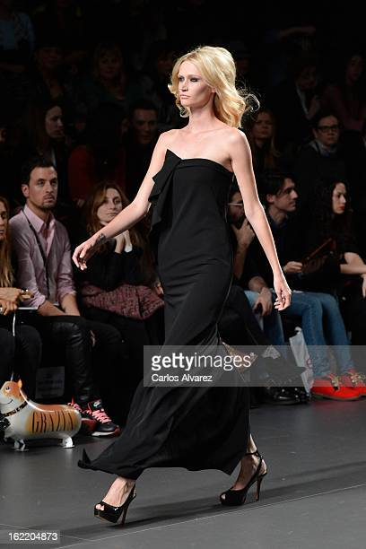 A model showcases designs by Devota Lomba on the runway at the Devota Lomba show during Mercedes Benz Fashion Week Madrid Fall/Winter 2013/14 at...