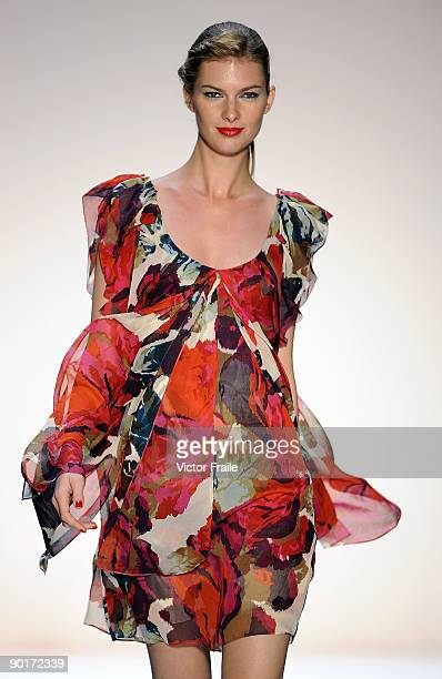 3933c753f03c A model showcases designs by Diane von Furstenberg on the catwalk as part  of the Red