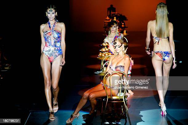 Model showcases designs by Dolores Cortes on the runway at Dolores Cortes show during Mercedes Benz Fashion Week Madrid Spring/Summer 2014 at Ifema...