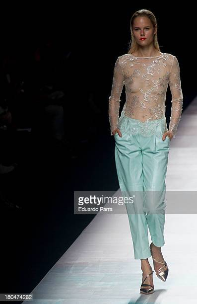 A model showcases designs by Duyos on the runway at Duyos show during Mercedes Benz Fashion Week Madrid Spring/Summer 2014 at Ifema on September 13...