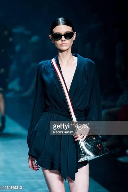 A model showcases designs by Elliatt at Melbourne Fashion Festival on March 7 2019 in Melbourne Australia