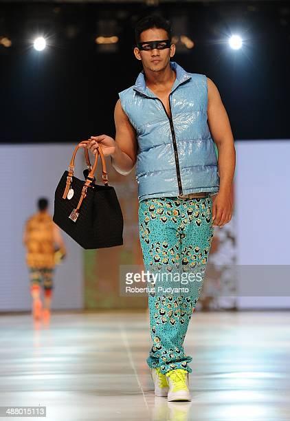 A model showcases designs by Embran Nawawi on the runway at The Men's Come Around show during The 7th Surabaya Fashion Parade 'NIWASANA NUSANTARA...