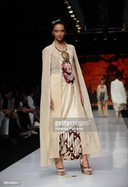 A model showcases designs by Era Soekamto on the runway at the Indonesian Fashion Designer Council show during Jakarta Fashion Week 2014 at Senayan...