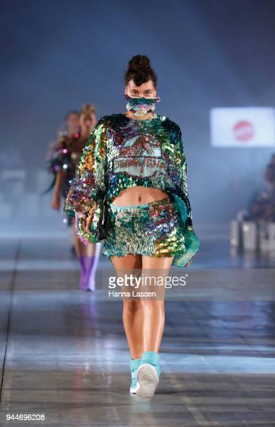A model showcases designs by EWOL during the Jurassic World Fallen Kingdom Runway Show on April 11 2018 in Sydney Australia