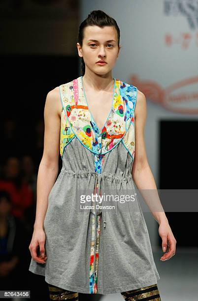 A model showcases designs by Fat as part of the Out of The Shadows catwalk show on the second day of Melbourne Spring Fashion Week 2008 at Melbourne...