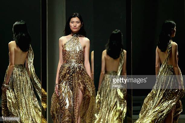 A model showcases designs by Ferragamo on the runway during the rehearsal of the Salvatore Ferragamo Spring Summer show at the Ullens Centre for...