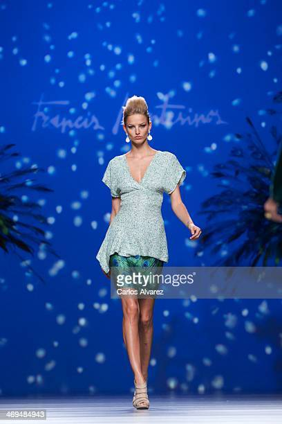A model showcases designs by Francis Montesinos on the runway at Francis Montesinos show during Mercedes Benz Fashion Week Madrid Fall/Winter 2014 at...