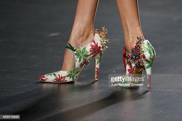 A model showcases designs by Francis Montesinos on the runway at the Francis Montesinos show during Mercedes Benz Fashion Week Madrid Spring/Summer...