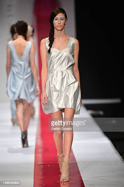 Model showcases designs by Garth Cook on the catwalk during StyleAID 2012 at the Burswood Entertainment Complex on July 27, 2012 in Perth, Australia.