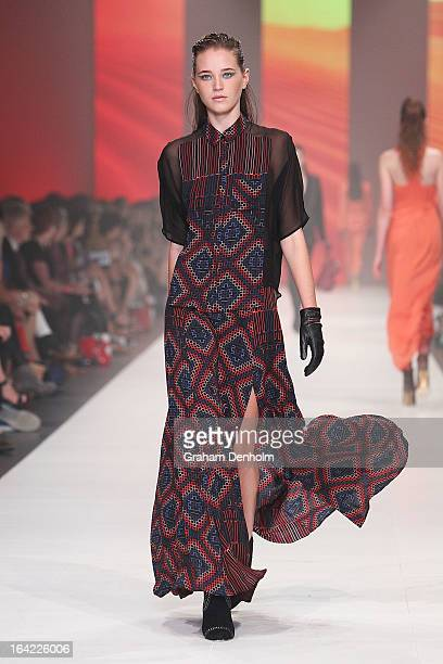A model showcases designs by Ginger Smart on the runway at the L'Oreal Paris Runway 3 show during day four of L'Oreal Melbourne Fashion Festival on...