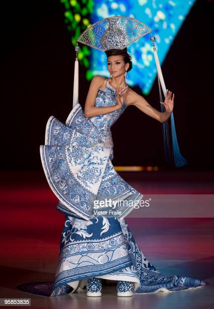 A model showcases designs by Guo Pei of China on the catwalk during the HK Fashion Extravaganza 2010 show as part of the Hong Kong Fashion Week...