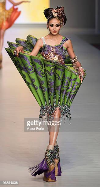 Model showcases designs by Guo Pei of China on the catwalk during the HK Fashion Extravaganza 2010 show as part of the Hong Kong Fashion Week...