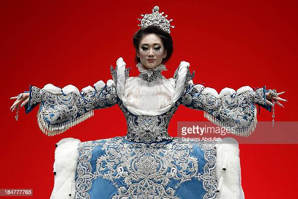 Model showcases designs by Guo Pei on the catwalk on day 8 of Fashion Week 2013 at the Sands Expo & Convention Centre on October 16, 2013 in...