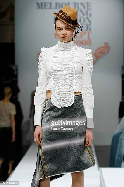 A model showcases designs by Gwendolyn as part of the Out of The Shadows catwalk show on the second day of Melbourne Spring Fashion Week 2008 at...