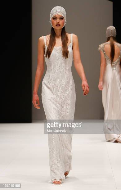 A model showcases designs by Gwendolynne on the catwalk on day 2 of Melbourne Spring Fashion Week 2012 at Melbourne Town Hall on September 4 2012 in...