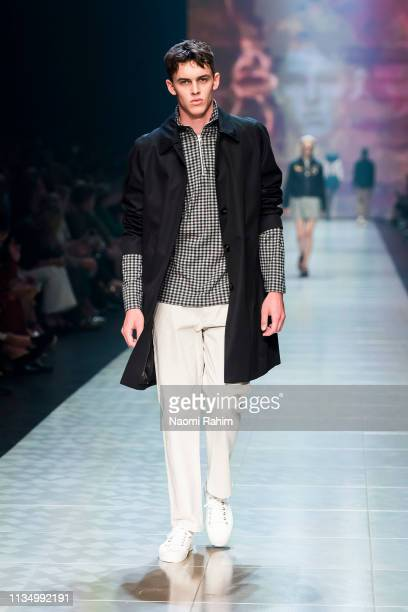 A model showcases designs by Handsom at Melbourne Fashion Festival on March 9 2019 in Melbourne Australia