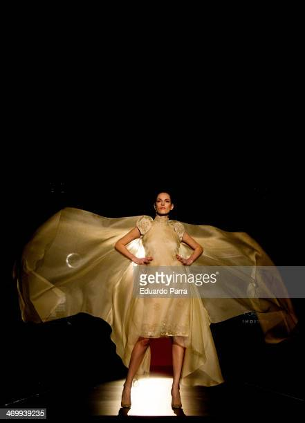 A model showcases designs by Hannibal Laguna on the runway at Hannibal Laguna show during Mercedes Benz Fashion Week Madrid Fall/Winter 2014 at Ifema...