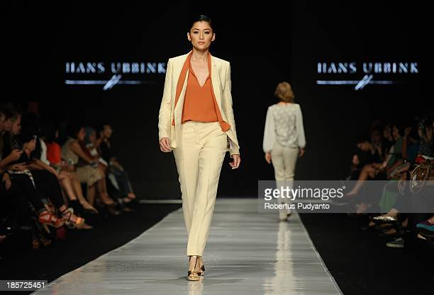 A model showcases designs by Hans Ubbink of Netherlands on the runway at the Erasmus Huis show during Jakarta Fashion Week 2014 at Senayan City on...