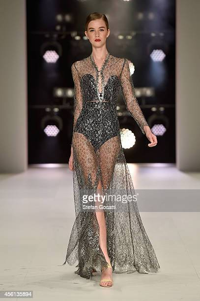 A model showcases designs by Hardwick during the Red Carpet runway show at MercedesBenz Fashion Festival Sydney at Sydney Town Hall on September 26...