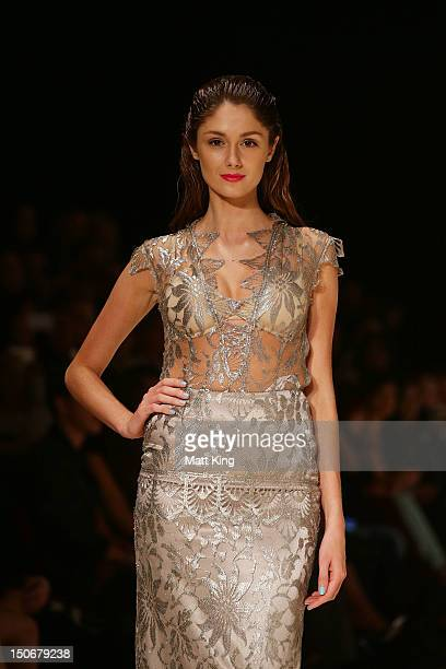 A model showcases designs by Hardwick on the catwalk during the Fashion Week Australia Review presented by Marie Claire as part of Mercedes Benz...