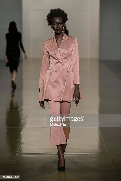 A model showcases designs by Harman Grubisa on the runway during 2016 New Zealand Fashion Week on August 22 2016 in Auckland New