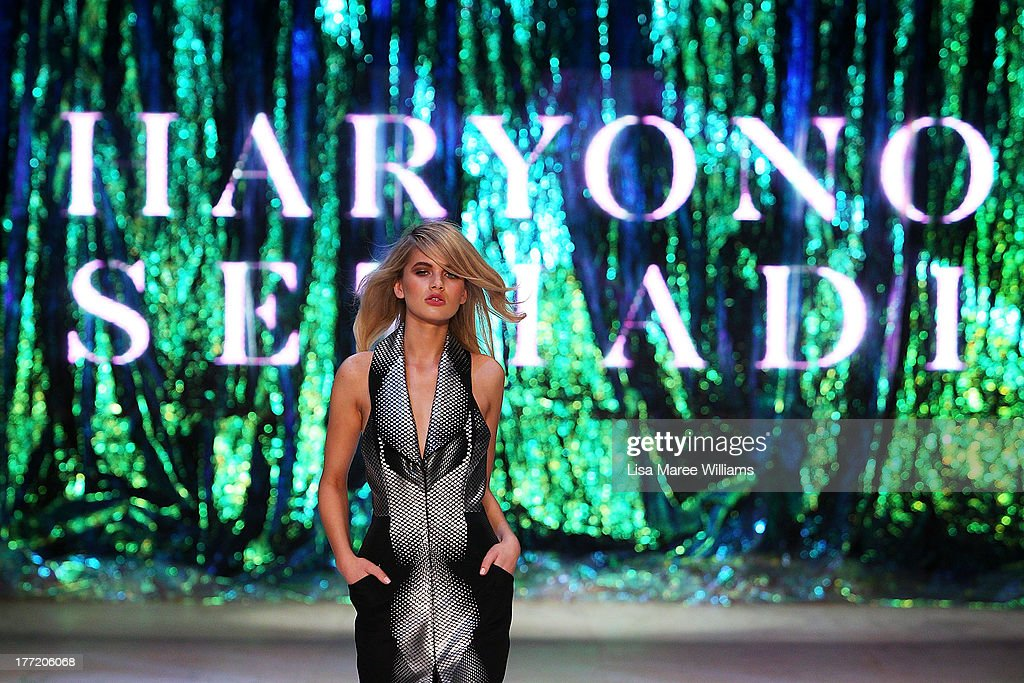 A model showcases designs by Haryono Setiadi on the runway at the InStyle Red Carpet Runway show during Mercedes-Benz Fashion Festival Sydney 2013 at Sydney Town Hall on August 22, 2013 in Sydney, Australia.